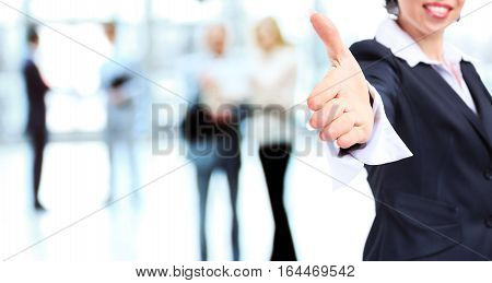 Business woman with hand extended to handshake. photo has a empty space for your text