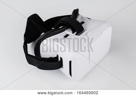 Virtual reality VR glasses or goggles isolated on white background with mirror reflection. Closeup product photograph. Computer simulated reality concept image with copy space 3D