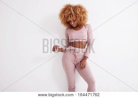 Blonde Black Woman Wears Pijama In Studio Shoot