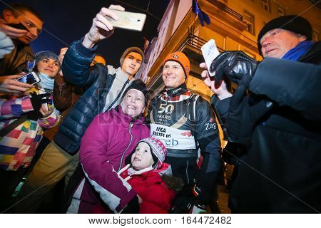 ZAGREB, CROATIA - JANUARY 4th, 2017 : Ski race of overall winners of the FIS World Cup on the ski slope in Bakaceva street, on the road from the cathedral to the main square. Audience taking photos with Ivica Kostelic while he is leaving ski race.