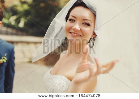 Pretty Bride Tries To Cath A Veil While Wind Plays With It