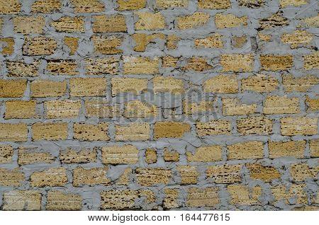 Texture of old shabby masonry stone limestone wall closeup