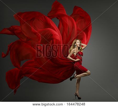 Fashion Model Red Dress Woman Dancing in Flying Fabric Gown Waving Fluttering Cloth