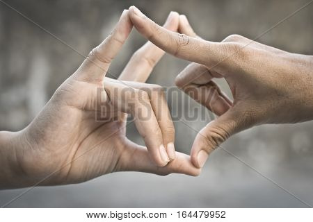 Human hand in the symbolic gesture. signs used by dumb & deaf.
