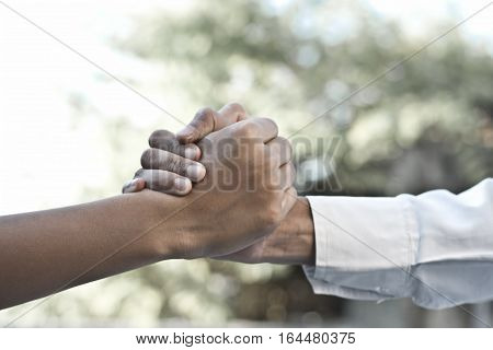 Shaking of human hands before the start of a game.