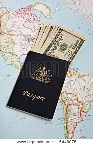 Australian passport and US banknotes with Map background