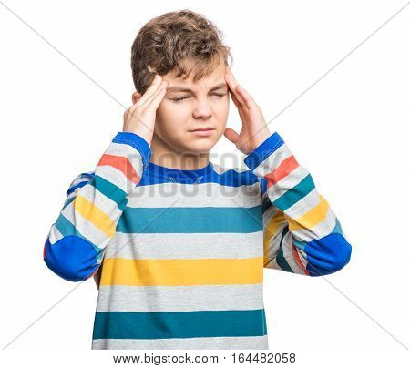 Stress and headache - teen boy having migraine pain. Handsome child suffering from a headache. Unhappy caucasian teenager touching his head, with eyes closed, isolated on white background.