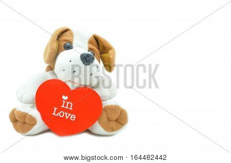 Cute beagle puppy doll showing red heart with in love wording.