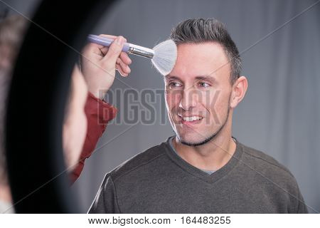Makeup Artist Working On Models Face