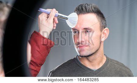 Makeup Artist Working On Models Face