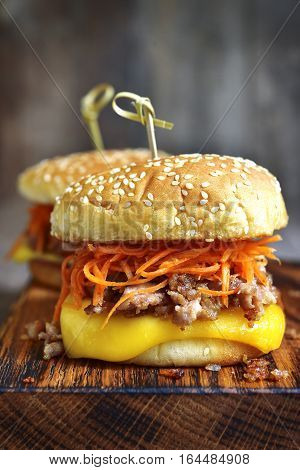 Homemade Cheeseburger With Fried Minced Meat And Spicy Carrot Salad.