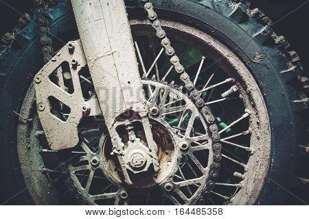 Dirty Motocross Bike Wheel Closeup Photo. Motocross Sport Theme.
