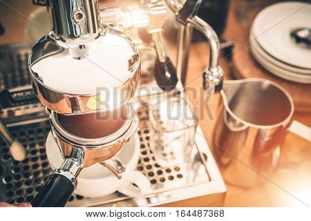 Manual Coffee Machines Espresso Making. Elegant Stainless Steel Coffee Machine and Portafilter Full of Fresh Arabica Coffee