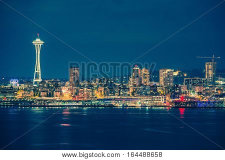 Part of the Seattle Skyline in the State of Washington United States. Seattle Skyline and the Bay During Night Hours.
