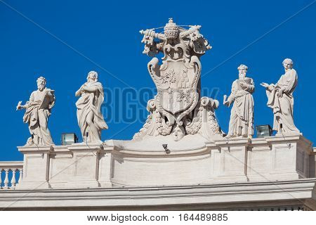 ROME, ITALY - January 24, 2016: A series of statues on the roof of the basilica of San Pietro in Vatican City in Rome. Italy.