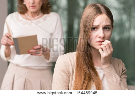 Concerned Teenage Girl And Mother