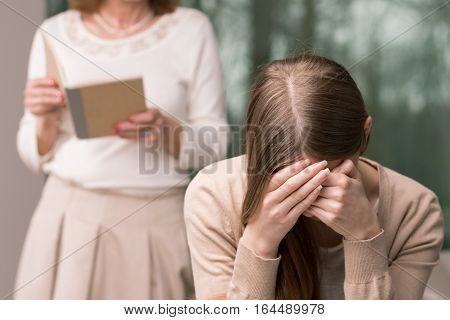 Embarrassed Girl And Mother With Diary
