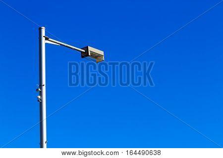 Street lamp light on blue sky background.