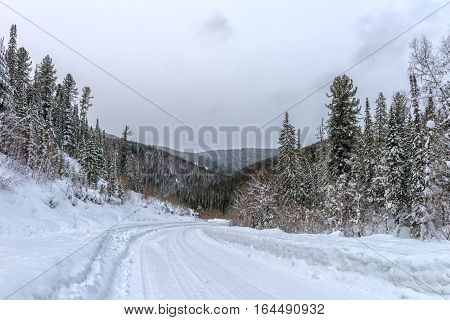 Winter road in Khakasia .Siberia mountains in snow