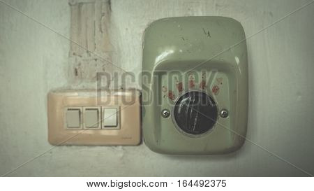 Vintage fan speed wall control and electric device.