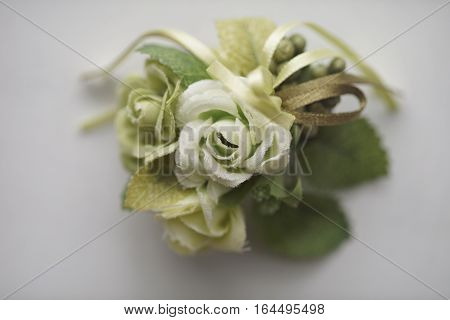 Beautiful floral bouquet with green flowers and leaves on a white background