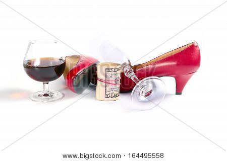 bright red women's leather shoes, rolled dollar and strong alcoholic drink as a symbol of selling love