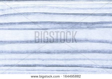 background of wood with a bluish paint strips