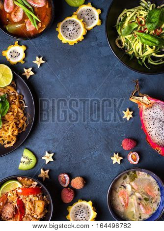 Thai food background. Dishes of thai cuisine. Tom yum tom kha gai pad thai noodles thai fried rice with pork and vegetables khao phat mu green papaya salad som tam thai fruits. Space for text