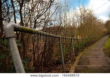 Path with steel handrail, nicely curved towards horizon