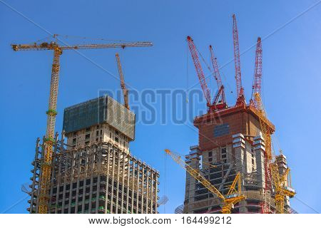 Construction of skyscrapers under blue sky close-up