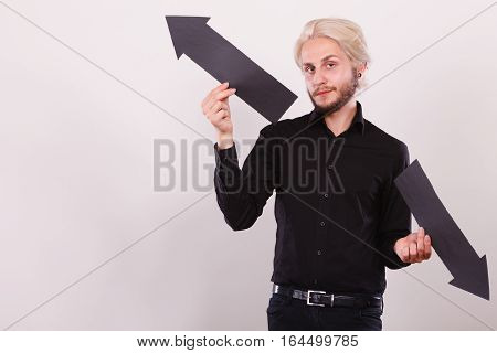 Man Holding Black Arrows Pointing Left And Right