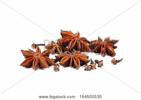 Aromatic star anise, cloves  isolated on white background