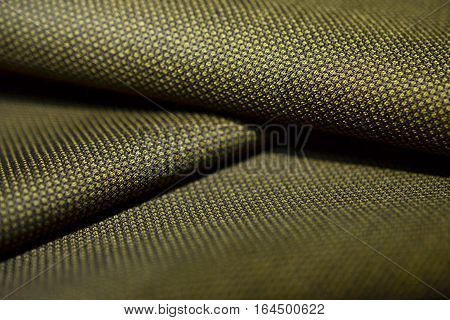 close up roll texture gold with black pattern of suit photo shoot by depth of field for object