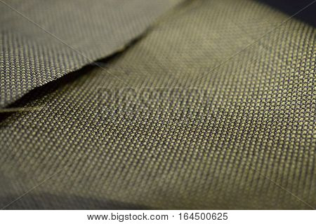close up gold with black pattern texture of suit photo shoot by depth of field for object