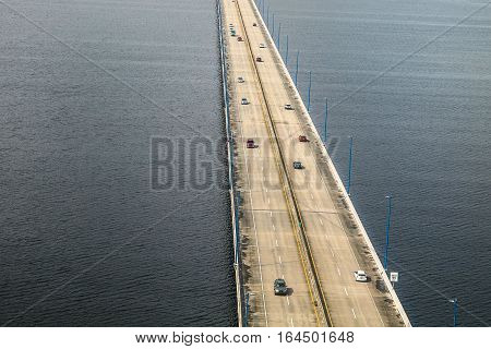 Aerial view of a low bridge with automotive traffic.