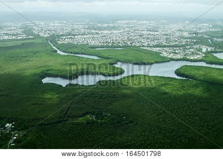 Aerial view of a city outskirts with wetlands.