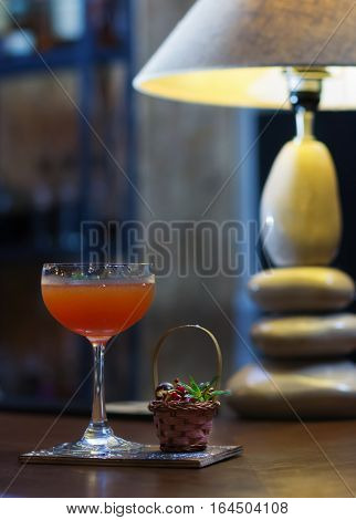 Alcoholic Cocktail With Cherry On The Bar
