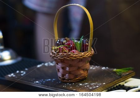 small basket with cherries, ornaments for cocktails