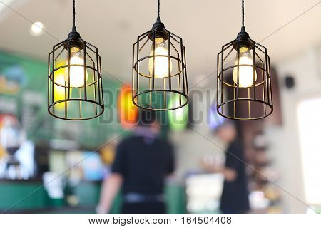 Vintage lamps in a restaurantconcept of interior with lights.