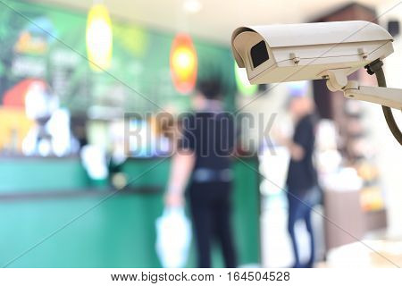 CCTV Camera Record on blur background of people in the cafeconcept of security and safety.