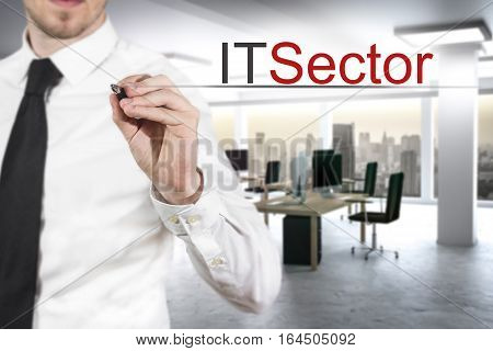 businessman in modern office building writing it sector in the air