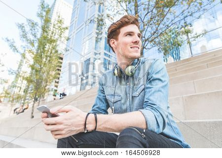 Man With Phone And Headphones In Chicago