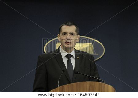 BUCHAREST ROMANIA - DECEMBER 23 2015: Petre Toba Minister of Internal Affairs speaks during a press conference.
