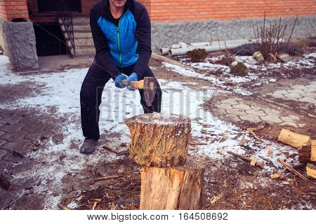 Sporty Man Chops Wood On The Farm