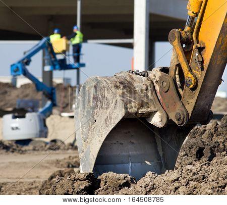 Excavator Bucket At Construction Site