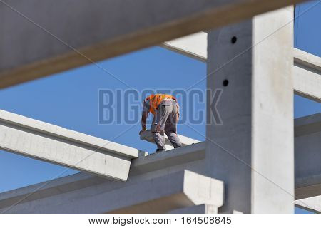 Construction Worker Assembling Concrete Truss