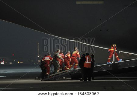 Romanian paramedics and medevac military personnel transport
