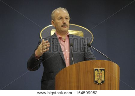 Bucharest Romania 5 December 2015: Romanian Vice Prime Minister and Minister of Regional Development and Public Administration Vasile Dincu speaks during a press conference at Bucharest Headquarters.