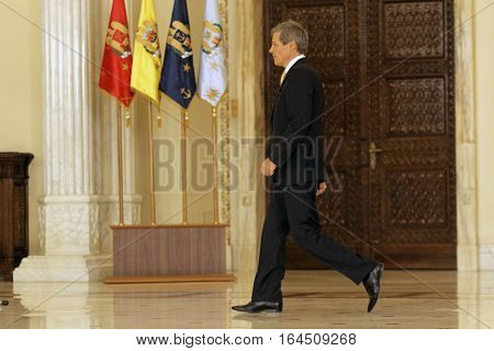 Romania's prime minister Dacian Ciolos walks during a swearing in ceremony at Cotroceni Palace the Romanian Presidency headquarters in Bucharest on 17 November 2015.