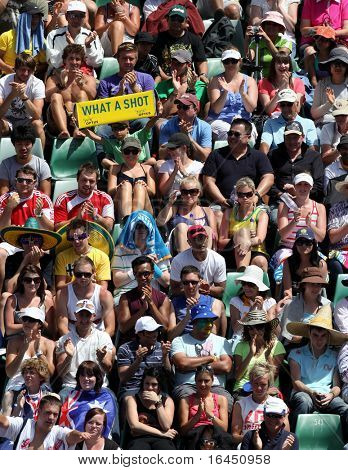 MELBOURNE, AUSTRALIA - JANUARY 26: Crowd watch a tennis game at the 2010 Australian Open at Rod Laver Arena on January 26, 2010 in Melbourne, Australia